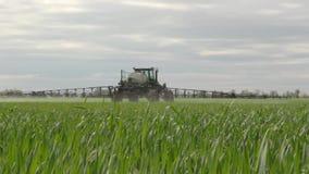 The sprayer sprays young wheat