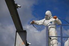 painter spraying the steel beams stock photos