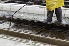 Spraying bitumen emulsion Stock Image