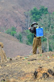 Spraying chemicals in the shifting cultivation. BAN NAMLOW, VIANGPHOUKHA, LUANGNAMTHA , LAO P.D.R - MAY 31 :Unidentified akha ethnic man is spraying chemicals in Stock Image