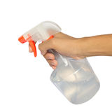 Spraying a cloth with laundry detergent in spray bottle Royalty Free Stock Photography