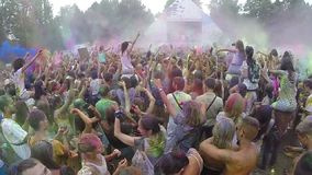 Spraying colored powder paint among crowd, festival slow motion. Stock footage stock video footage