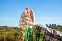 spraying the detergent on glass stock image