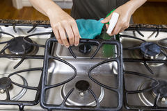 Spraying down Stove Top Range for Cleaning Stock Photography
