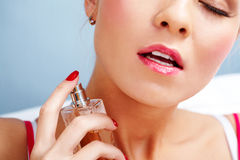 Spraying eau de toilette Royalty Free Stock Image