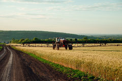 Spraying fertilization of wheat fields Stock Photography