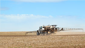 Spraying Fertilizer. Sprayer spraying fertilizer onto a farm field Royalty Free Stock Image