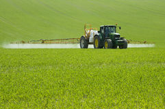 Spraying the field Stock Images