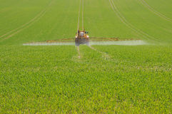 Spraying the field Stock Photography