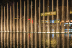 Spraying fountains at night Royalty Free Stock Photography