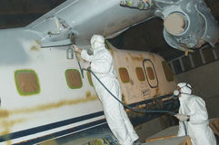 Spraying the fuselage Stock Images