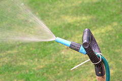 Spraying garden water hose Royalty Free Stock Images