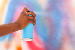 Spraying graffiti aerosol Stock Photography