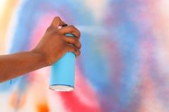Spraying graffiti aerosol Stock Photography