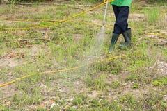 Spraying herbicide. A man is spraying herbicide in fram Royalty Free Stock Image