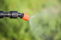 Spraying herbicide from the nozzle of the sprayer manual. Devices for processing plants in the garden royalty free stock images