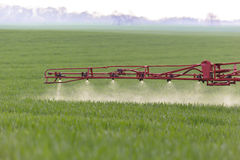 Spraying. The herbicides on the green field Royalty Free Stock Images