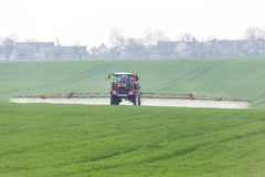 Spraying. The herbicides on the green field Royalty Free Stock Photography