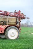 Spraying the herbicides on the green field Stock Photo