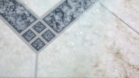 Spraying liquid cleaner on dirty tile stock video