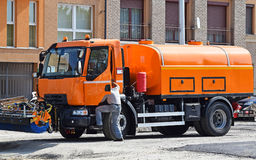Spraying lorries at the road construction Stock Image
