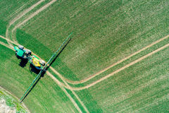 Spraying machine on the field. Aerial view on the spraying machine on the field Royalty Free Stock Photography