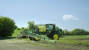 Spraying machine preparing to irrigation on farming field. Farming machinery