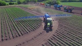 Spraying machine watering agricultural field. Drone view agriculture watering stock footage