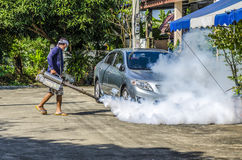 Spraying mosquito repellent. PATHUMTHANI PROVINCE, THAILAND - NOVEMBER 16 2014 : Unidentified man spraying mosquito repellent in village called  GREEN GARDEN Royalty Free Stock Photos