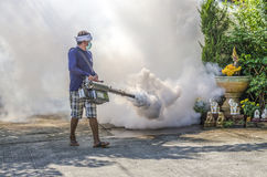 Spraying mosquito repellent. PATHUMTHANI PROVINCE, THAILAND - NOVEMBER 16 2014 : Unidentified man spraying mosquito repellent in village called  GREEN GARDEN Stock Images