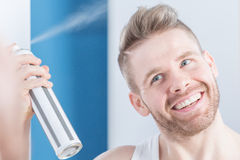 Spraying new hairstyle Royalty Free Stock Photography