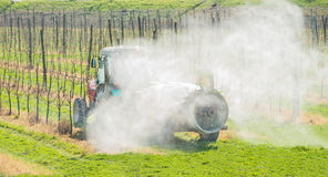 Spraying orchard Stock Photography
