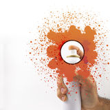 Spraying with paint. And colored splash in white background Stock Image