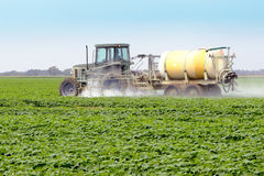 Spraying Pesticides - 4. The application of pesticides on a commercial agricultural field Stock Photo