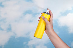 Spraying poison in the air. Hand spraying a substance like insecticide into open air Royalty Free Stock Photo
