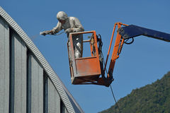 Spraying the roof Stock Images