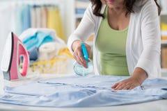 Spraying shirt Stock Images