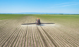 Spraying soya bean field. At spring Stock Images