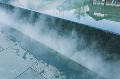 Spraying water with air and cooling air outdoors in hot summertime. Pulverizes spraying water with air and cooling air outdoors in hot summertime stock photos