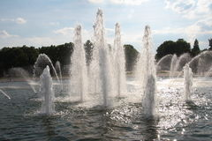 Spraying water fountain. Against sky royalty free stock photo
