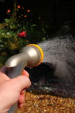 Spraying water on garden C Stock Photography