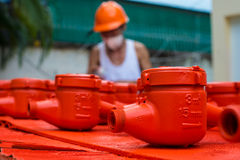 Spraying water meter. Spraying color many water meter in the factory Stock Photo