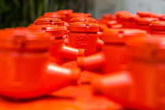 Spraying water meter. Spraying color many water meter in the factory Stock Photography