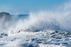Spraying Waves. Huge Crashing waves on rocks Stock Image