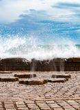 Vertical sprays of sea water passing thourgh a floor channles in. Sprays of sea water passing thourgh a floor channles in sculpture The Comb of the winds in San Royalty Free Stock Photography