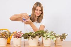 She sprays from a spray houseplants Royalty Free Stock Image