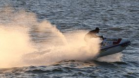 Sprays of water are created from the fast moving water craft. Royalty Free Stock Photos