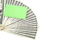 Spread of cash with blank card for text Royalty Free Stock Photography