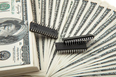 Spread of cash with silicon chips Stock Photography