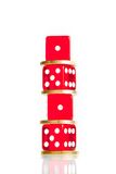 Spread, the euro coins and dice red stacked Royalty Free Stock Images